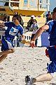 taylor lautner face sand football 01