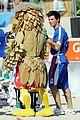 taylor lautner face sand football 05