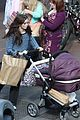 lily collins pushes stroller on love rosie set 05
