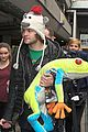 the wanted jay mcguiness carries froggy friend at the airport 07