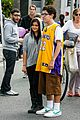 ariel winter makes a furry friend at the farmers market 04