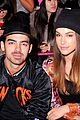 joe jonas blanda eggenschwiler sit together at custo barcelona fashion show 04