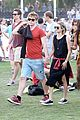 emma roberts and evan peters hold hands at coachella 201412