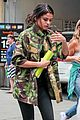 selena gomez covers up camo jacket 10