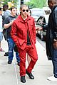 nick jonas red suit aol build appearance 15