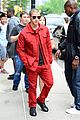 nick jonas red suit aol build appearance 16