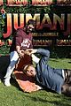 jack black nick jonas face off during jumanji promo 02