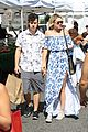nolan gould hannah glasby hold hands famers market 03