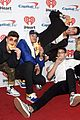 prettymuch poses with pizza cuddles with puppies at iheartradio music festival 07