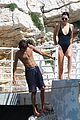 kendall jenner rocks black thong swimsuit while poolside in cannes 09