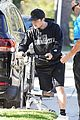 josh hutcherson makes a coffee run on his injured leg 04