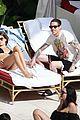 kaia gerber pete davidson kiss poolside in miami 090