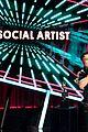 addison rae accepts harry styles award on his behalf at billboard music awards 02