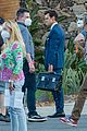harry styles looks dapper in two suits on dont worry darling set in palm springs 21