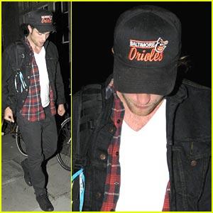 Robert Pattinson Hides In Notting Hill