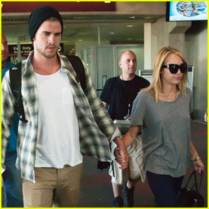 Miley Cyrus &#038; Liam Hemsworth: Airport Arrival with Ziggy!