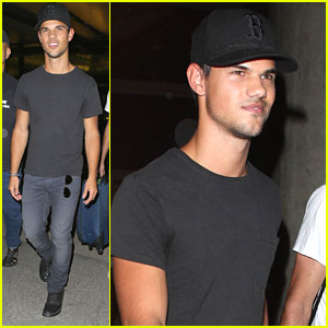 Taylor Lautner: Black Ball Cap at LAX