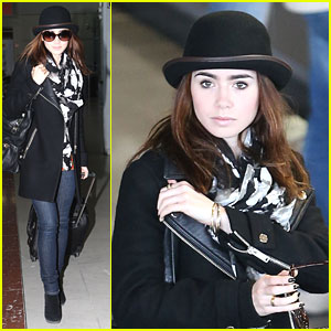 Lily Collins: Bowler Hat Arrival in Paris