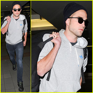 Robert Pattinson Lands at LAX Airport