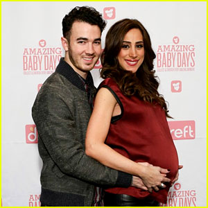 Kevin Jonas Holds Danielle's Large Baby Bump at App Launch Event!