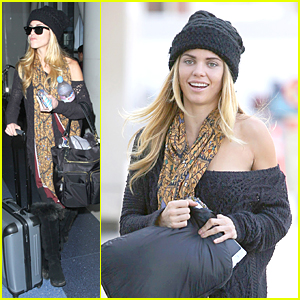 AnnaLynne McCord Brings a Smile to Poor Cambodian Boy's Face