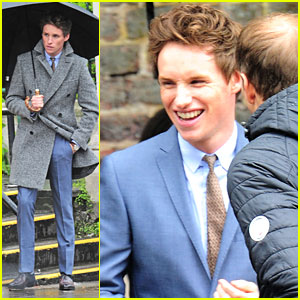 Eddie Redmayne Stays Out Of The Rain On Photo Shoot in London