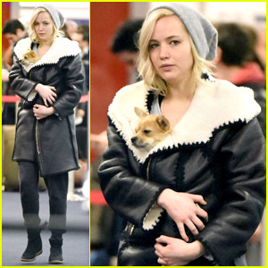 Jennifer Lawrence Carries Her Cutie Pie Pup in Her Coat at the Airport!