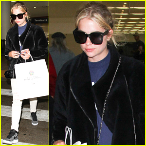 Ashley Benson Picks Up Cupcakes After Flight Back To LA