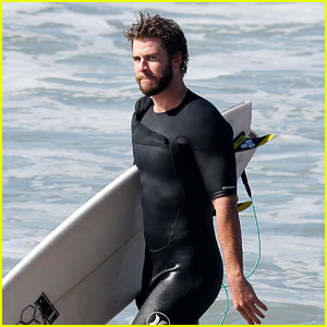 Liam Hemsworth Rocks a Wetsuit While Surfing