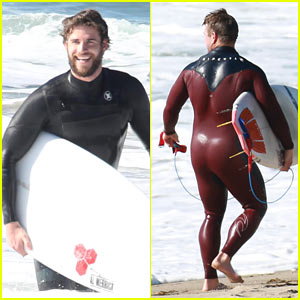 Liam Hemsworth Hits the Waves in Malibu With Brother Luke
