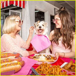 Influencers Natasha Bure & Bella Giannulli Are All About National Hot Dog day with Happy The Rescue Pup