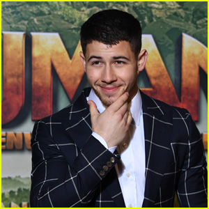 Nick Jonas Poses for Photos While Promoting 'Jumanji' in Paris!