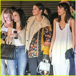 Selena Gomez Keeps Warm For Night Out with Friends