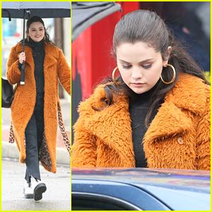 Selena Gomez Keeps Warm From Chilly Weather In Fuzziest Orange Coat on 'Only Murders' Set