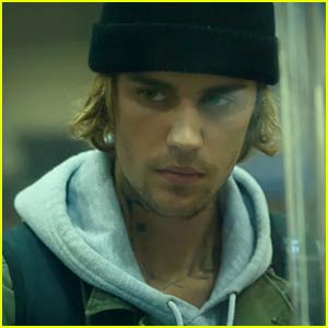 Justin Bieber Robs a Bank & Gets Into a Motorcycle Chase in 'Hold On' Video