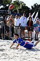 Lautner-football taylor lautner face sand football 17