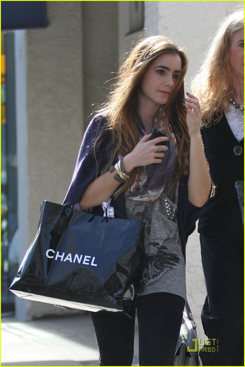 lily collins chanel shopping party 21