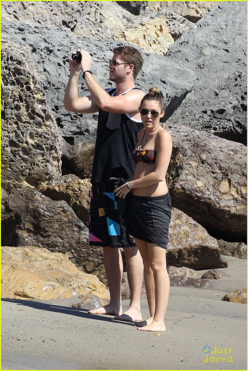 Miley Cyrus in Red Bikini and Liam Hemsworth at the beach in Malibu Pic 14 of 35