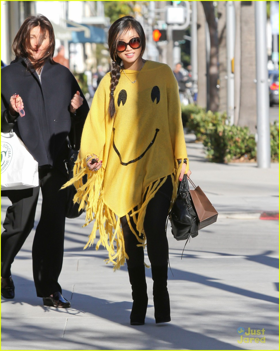 brenda song smiley face poncho 08