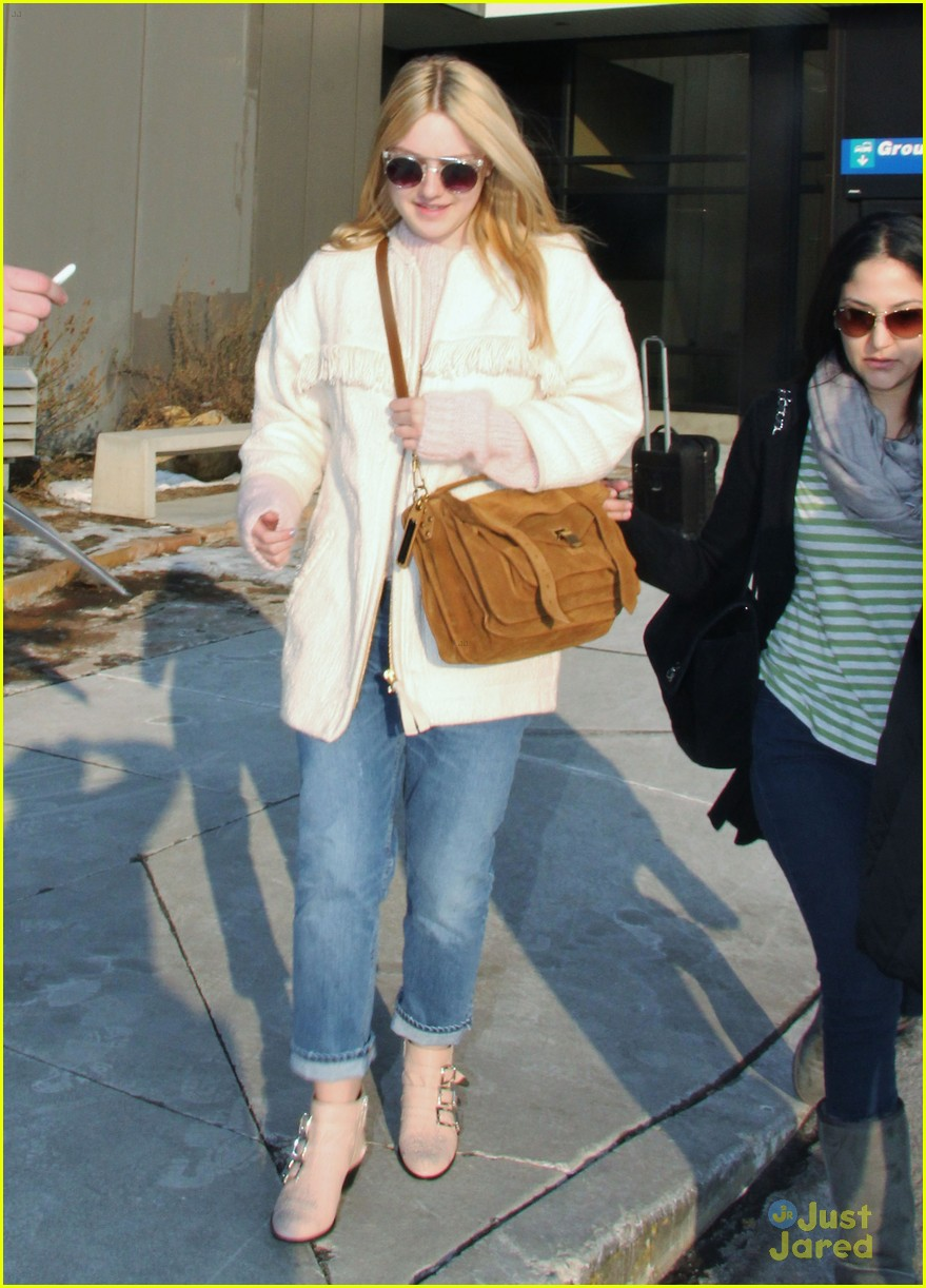 dakota fanning slc takeoff 02