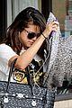 Selena-tanning selena gomez tanning salon exit 01