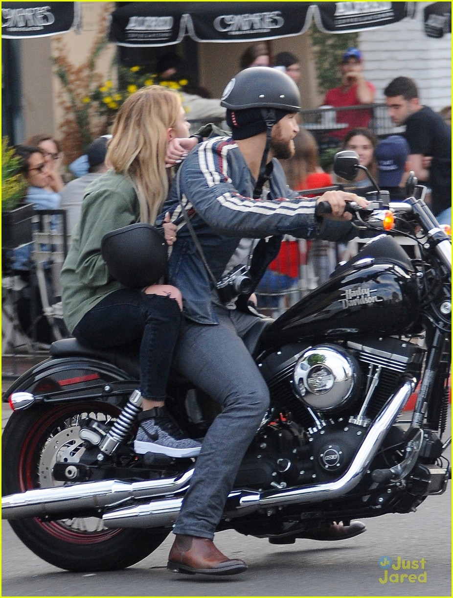 ashley benson gets motorcycle ride from keegan allen