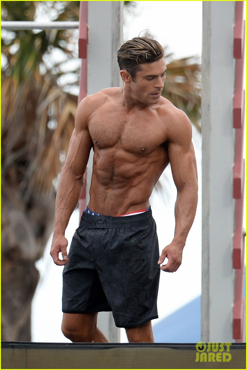zac efron puts his chiseled abs on display for 39 baywatch. Black Bedroom Furniture Sets. Home Design Ideas