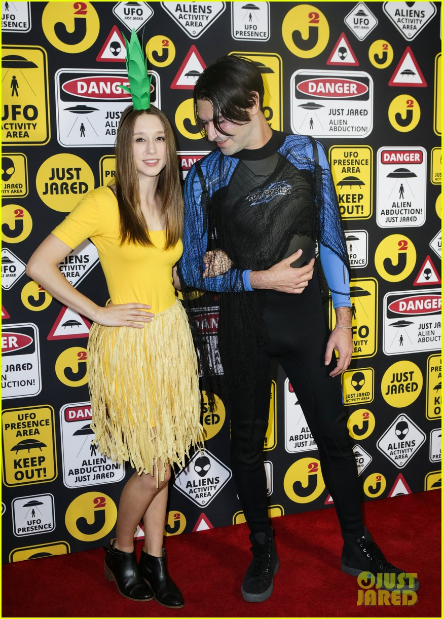 zoey deutch taissa farmiga meet at just jared halloween party 01