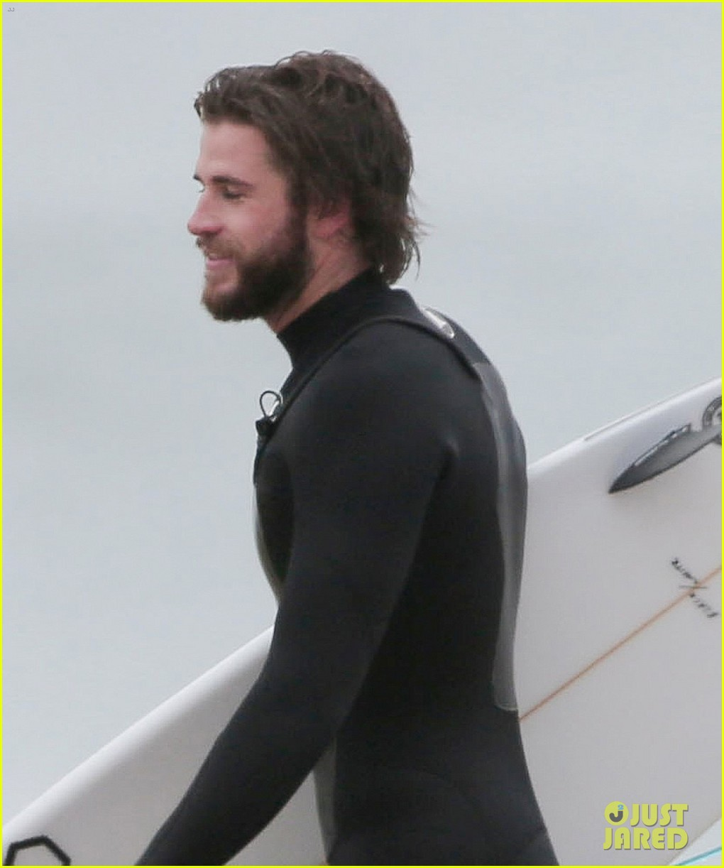 liam hemsworth hits the waves to kick off weekend 02