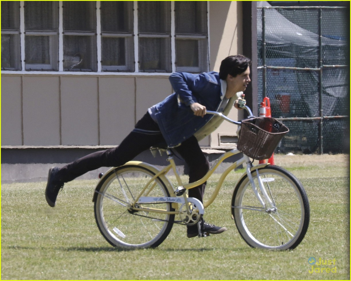 cole sprouse rides bike riverdale set 05
