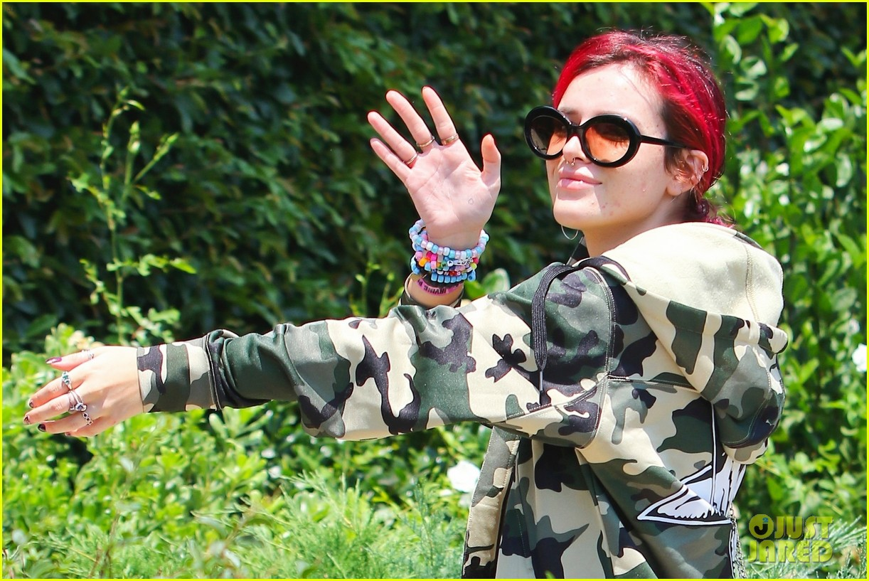 bella thorne leaves little to the imagination in plunging 26