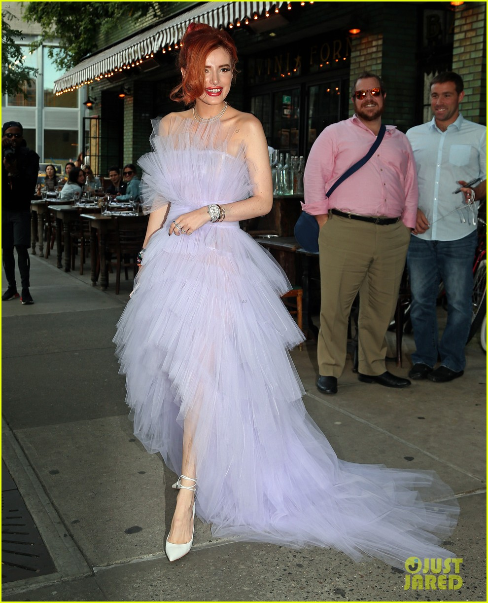 bella thorne wears flowing purple tulle gown to daily front row awards 01