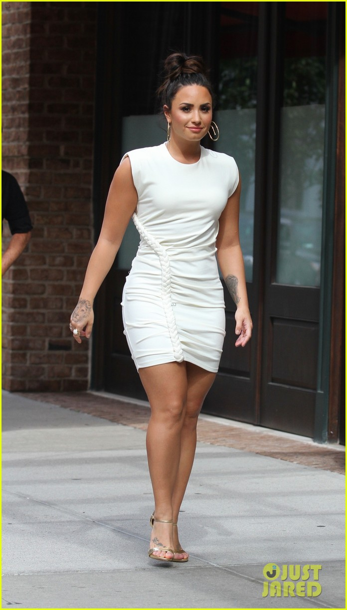 demi lovato wears a dress with a braid down the side 05