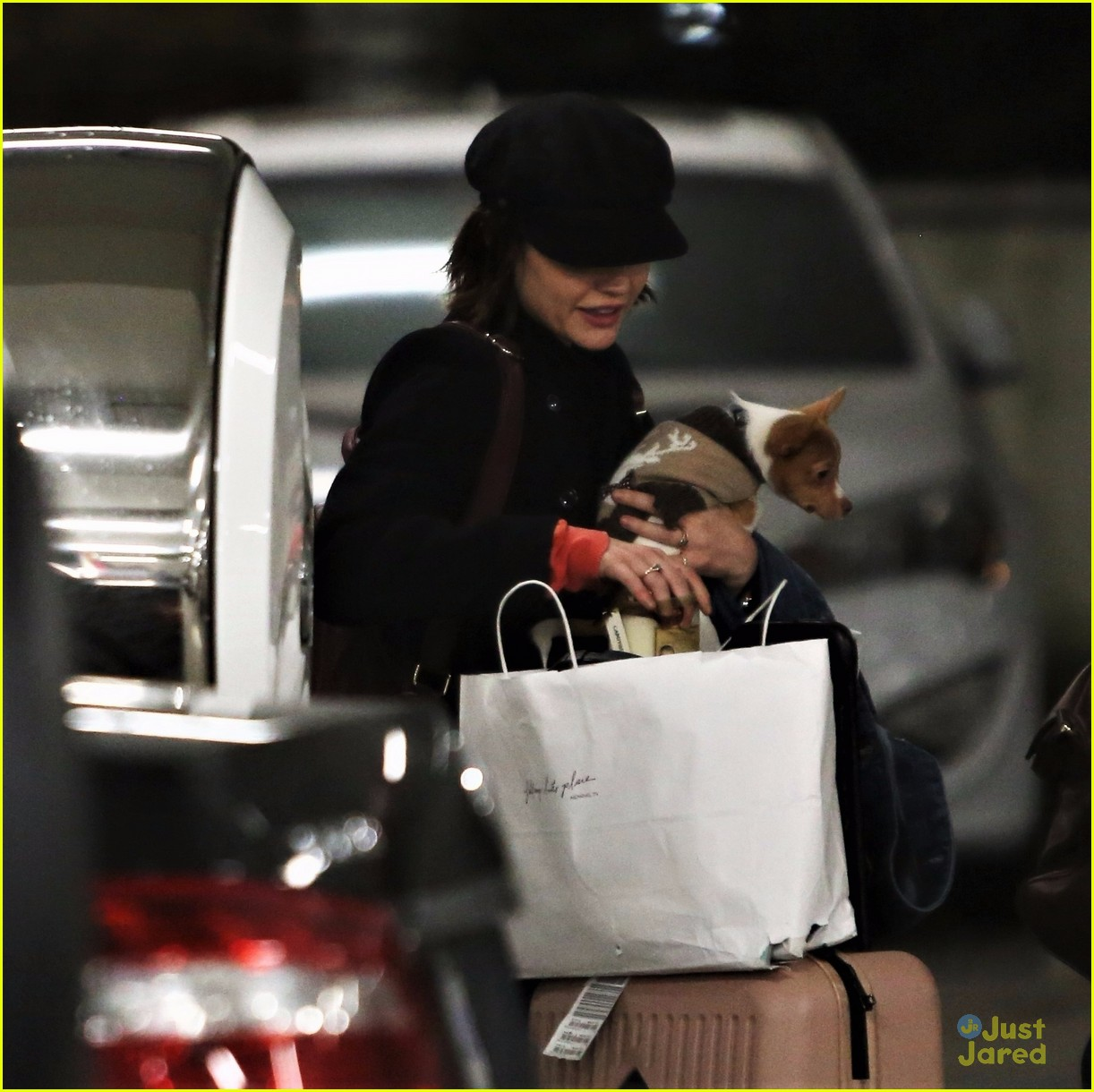lucy hale puppy kisses vancouver arrival 02